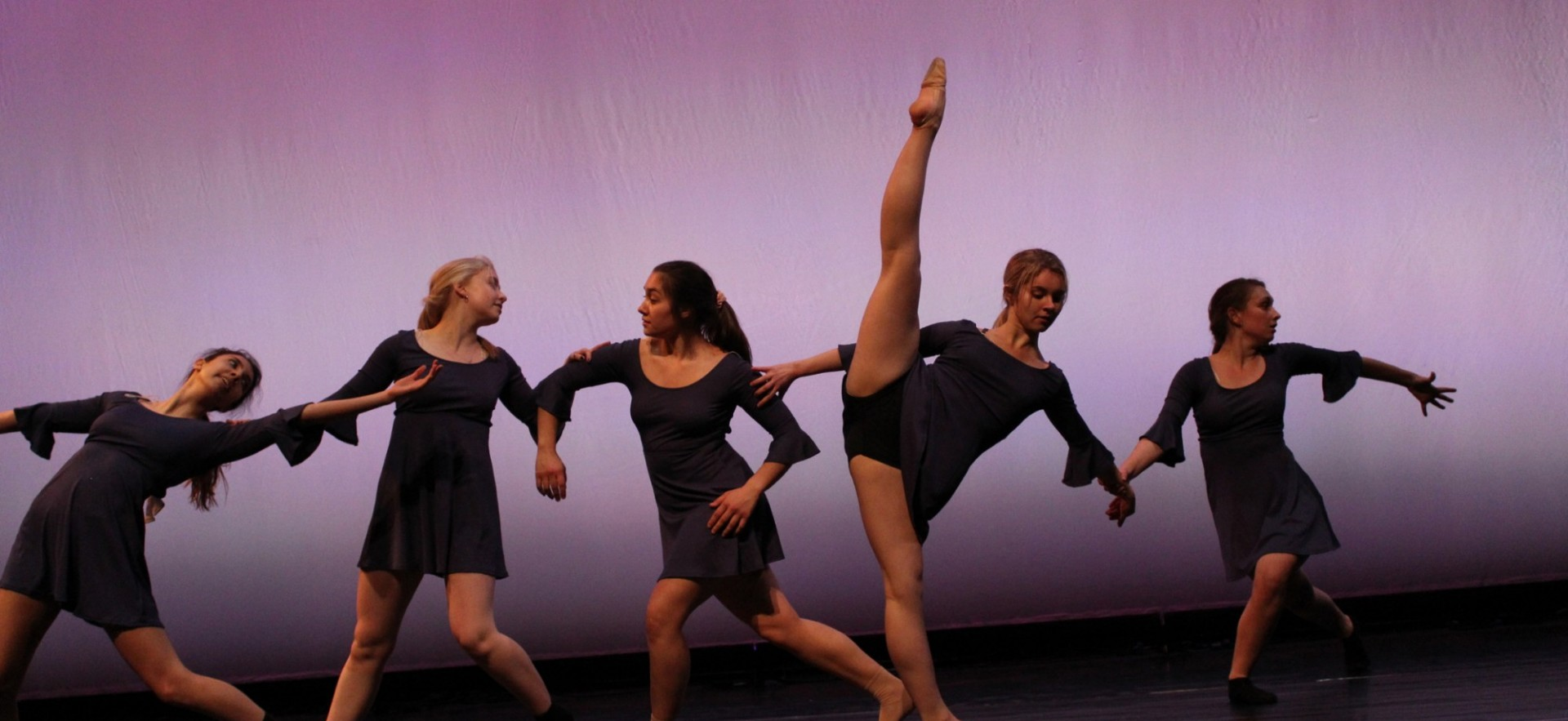 Dancers from our Spring 2019 show performing choreography by Gianna Raimo and Zoe Novello onstage.