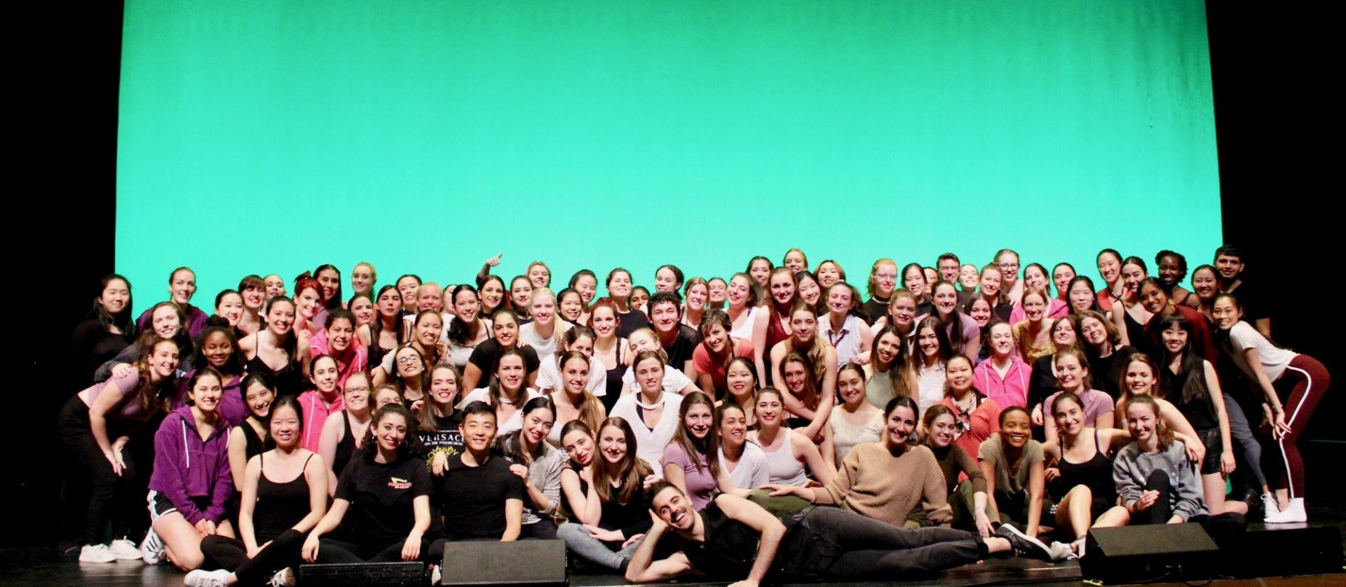 Group photo onstage of the entire 150-person cast of our Spring 2019 performance.